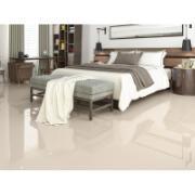 Imagem de um quarto com o porcelanato avorio aplicado no piso